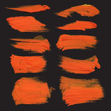 Abstract strokes drawn thick orange paint on black Stock Photo