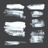 Abstract strokes drawn thick white paint on black paper Royalty Free Stock Photography