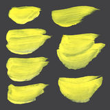 Abstract strokes drawn thick yellow paint on black pap Royalty Free Stock Photography