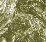 Abstract  structure of rocks in natural colors. Brown and green abstract background resembling structure of rock Royalty Free Stock Images