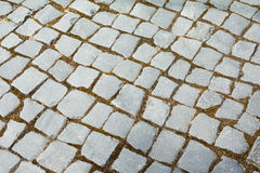 Abstract structured background of an old street pavement slabs pattern. Stone paving texture. Abstract structured background of an old street pavement slabs Royalty Free Stock Photography