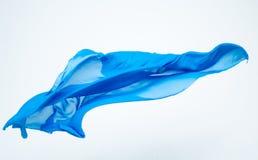Abstract stuk van het blauwe stof vliegen Stock Fotografie