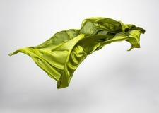 Abstract stuk van het groene stof vliegen Stock Afbeeldingen