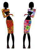 Abstract stylish slender women in ornate dresses Royalty Free Stock Images