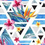 Abstract summer geometric seamless pattern with exotic flowers. Abstract summer geometric seamless pattern. Triangles with watercolor tropical flowers, palm Stock Photo
