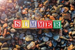 Abstract summer text close up colorful shiny textured background. Abstract summer close up colorful shiny textured background. Text composed from grungy nice Royalty Free Stock Image