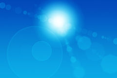 Abstract Sun Flares. Sun flares on a blue abstract background Royalty Free Stock Photo