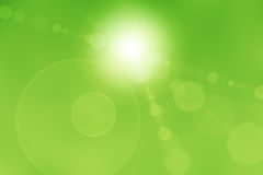 Abstract Sun Flares. Sun flares on a green abstract background Stock Photo