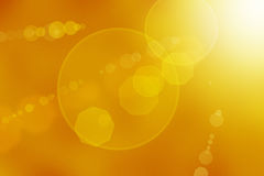 Abstract Sun Flares. Sun flares on a yellow abstract background stock photo
