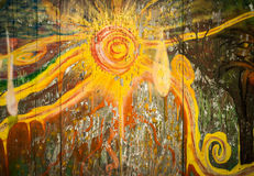 Abstract Sun Graffiti. Urban abstract painting of the sun on wooden background Stock Image