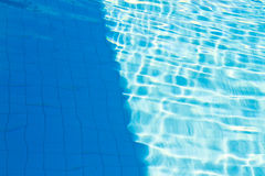Abstract of sun reflected in the water of the swimming pool : Bl Royalty Free Stock Photo