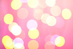 Abstract sunny bokeh on pink Royalty Free Stock Photos