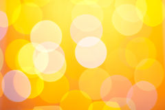 Abstract sunny bokeh on yellow Royalty Free Stock Images
