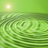 Abstract sunrise. Over green sea Royalty Free Stock Photography