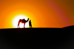 Abstract Sunrise: Man And Camel,Desert Silhouettes Royalty Free Stock Photo