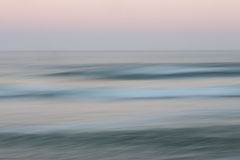 Abstract sunrise ocean background with blurred panning motion. Abstract sunrise ocean with sky background with blurred panning motion causing soft feel Royalty Free Stock Images