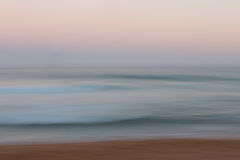 Abstract sunrise ocean background with blurred panning motion Stock Photo