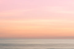 Abstract sunrise sky and  ocean nature background. Abstract sinrise sky and  ocean nature background with blurred panning motion Stock Photography