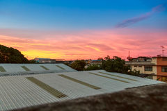 Abstract sunrise sky over roof top Stock Images