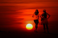 Abstract Sunset. An abstract background of two women watching the sun go down Stock Photos