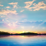 Abstract sunset background with forest lake Stock Images