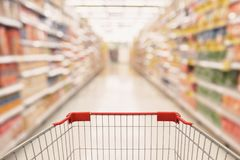 Abstract Supermarket aisle with shopping cart Royalty Free Stock Photos