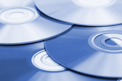 Abstract surface of cd disc. Toned to blue image Royalty Free Stock Image