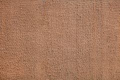 Wrinkled brown decorative stucco surface, abstract texture backdop. stock photography
