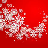 Abstract swirl of paper snowflakes on a red background Stock Photo