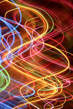 Abstract swirling streaks. An abstract background appearing to be colorful swirling streaks of light stock photography
