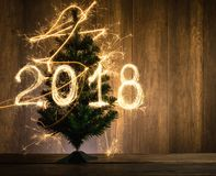 Abstract Symbolic Christmas tree with 2018 created using sparkle Stock Photo