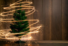 abstract Symbolic Christmas tree created using sparklers with wo Stock Images