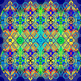 Abstract symmetric pattern. From rings and interlacings on a gradient background in dark blue, green and yellow colors Stock Image