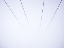 Abstract symmetry lines. Symmetry lines of rope cableway ski lift at thick fog Royalty Free Stock Images