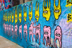 Abstract teeth and eyes graffiti art Stock Image