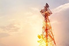 Abstract telecommunication tower Antenna and satellite dish at s. Unset sky background Royalty Free Stock Image