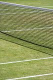Abstract tennis pattern. Tramlines, centre lines and net cross over to create a nice interesting and abstact photo Stock Photo