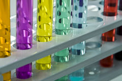 Abstract test tubes. Colorful image and interesting reflections on a test tubes stand; unmodified specific lighting for a laboratory Stock Image