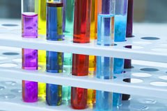 Abstract test tubes. Colorful image of a test tubes stand; unmodified specific lighting for a laboratory Royalty Free Stock Image