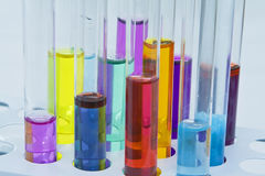 Abstract test tubes. Colorful image of a test tubes stand; unmodified specific lighting for a laboratory Royalty Free Stock Photos