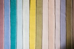 Abstract textile background multicolored stripes from factory upholstery textiles for furniture royalty free stock photos