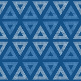 Abstract textile blue triangles ikat seamless. Vector abstract textile blue triangles ikat seamless pattern background Vector Illustration