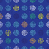 Abstract textile polka dots on blue seamless pattern background Stock Photography