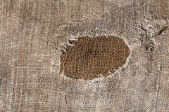 Abstract textile sack texture with patch. Royalty Free Stock Photography