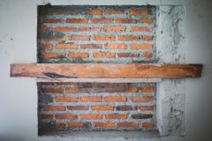 Abstract texture and background of red bricklayer wall and wooden plate for supporting stock image