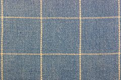 Abstract texture of blue cotton fabric with vertical and horizontal dots lines Royalty Free Stock Image