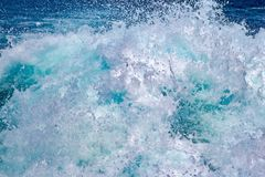Abstract texture. Blue sea and waves. Foam on the water.  stock photos
