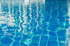 Abstract texture of blue wave water in swimming pool. Selective focus Stock Photos
