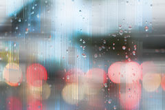 Abstract texture and bokeh effect. Photograph and digital manipulation of a traffic scene through a wet glass and with bokeh effect Stock Images