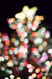 Abstract texture of colorful Christmas lights background blurs. In vertical frame Royalty Free Stock Image